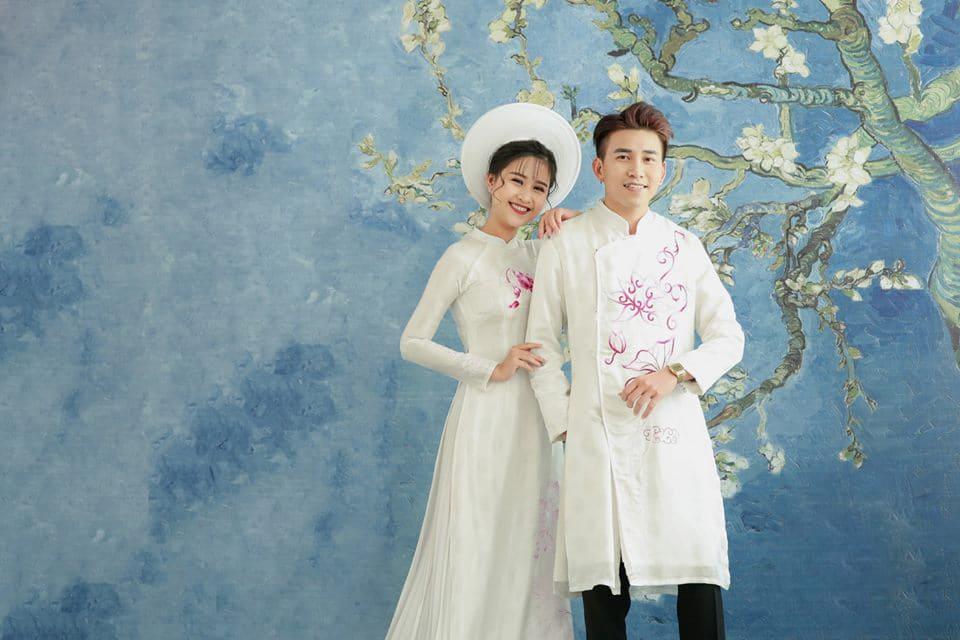Áo dài cưới trắng đơn giản hoa văn Mate.vn