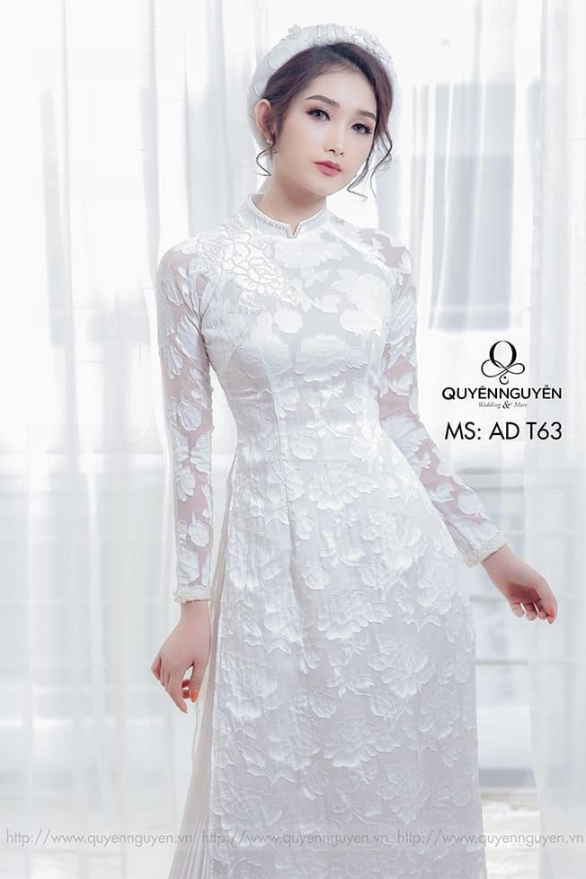 Áo dài cưới trắng đơn giản hoa lá Mate.vn